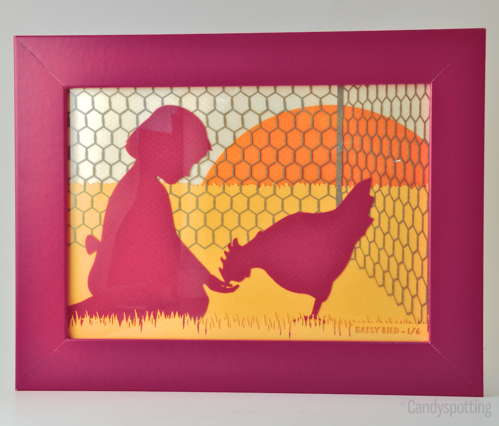 Papercut of a girl feeding a chicken